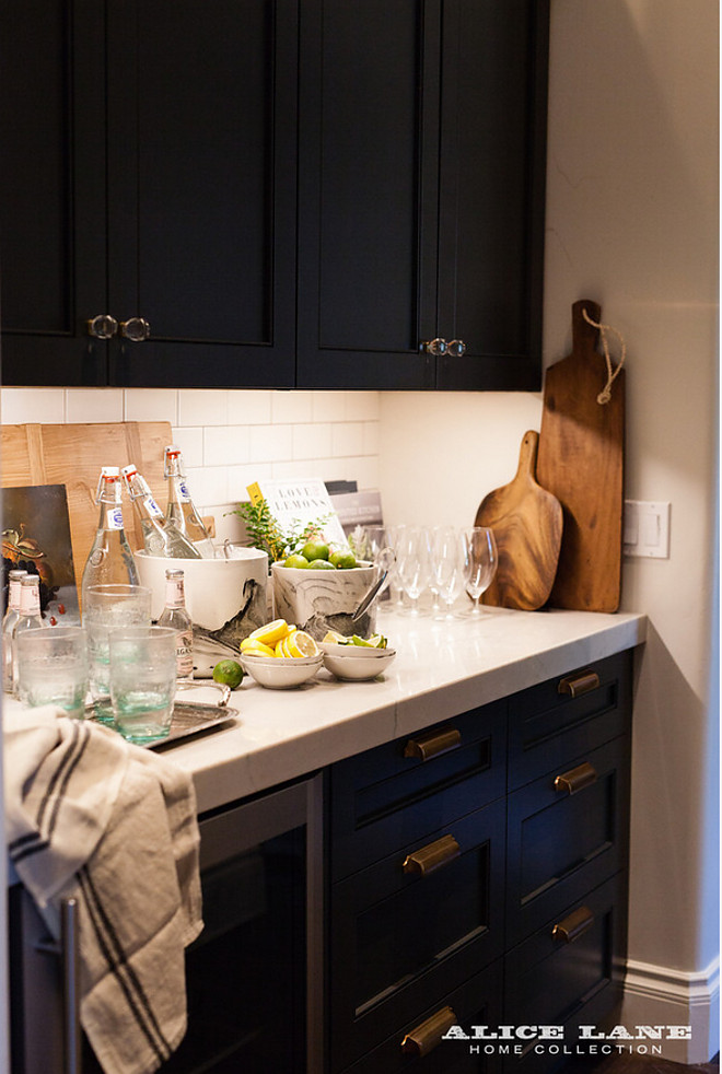 Butlers pantry with black cabinets and brass hardware. Alice Lane Home Collection