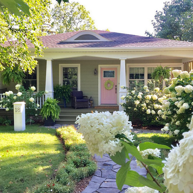 Cottage with porch and pink front door Siding is James Hardie Heathered Moss #JamesHardieHeatheredMoss #cottage #frontporch #pinkfrontdoor #pink #door