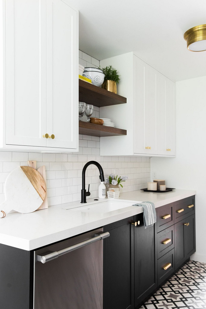 Countertop is white quartz. Backsplash is white subway tile with light grey grout