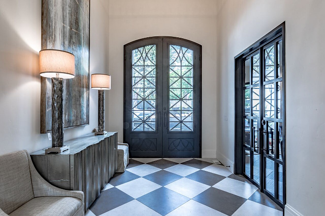 Custom Wrought Iron and Glass front door. The front door measures 11′ x 7′ and it is by Iron Door Works. Tree Haven Homes & Danielle Loryn Design