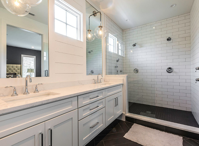 Famrhouse Bathroom with white subway tile walls and black herringbone floor tile Farmhouse bathroom with shiplap,white subway tile walls and black herringbone floor tile