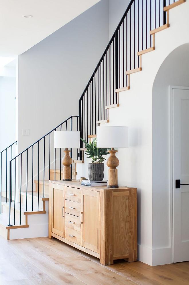 Farmhouse Foyer Modern farmhouse foyer features a custom staircase with wrought iron stair railing