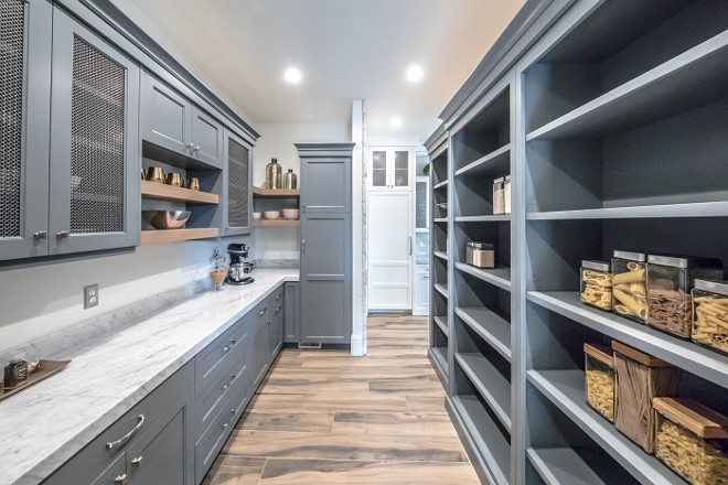 Grey pantry. Walk in pantry with grey cabinets. This home also features a walk-in pantry with grey cabinets and Carrara marble countertop. Grey pantry #Grey #pantry Tree Haven Homes & Danielle Loryn Design