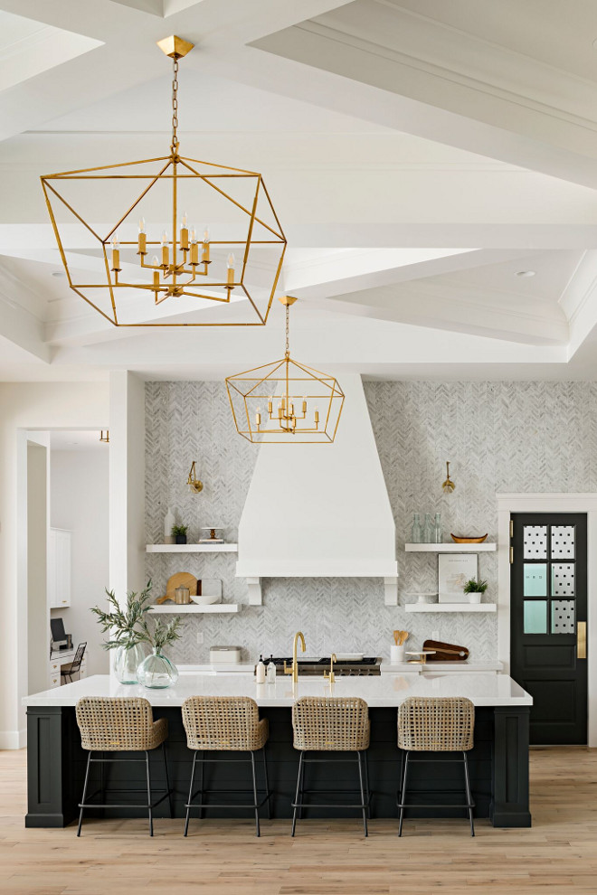 Lighting is Gabby Lighting's Adler chandelier - no longer available in brass - only in bronze. A Finer Touch Construction