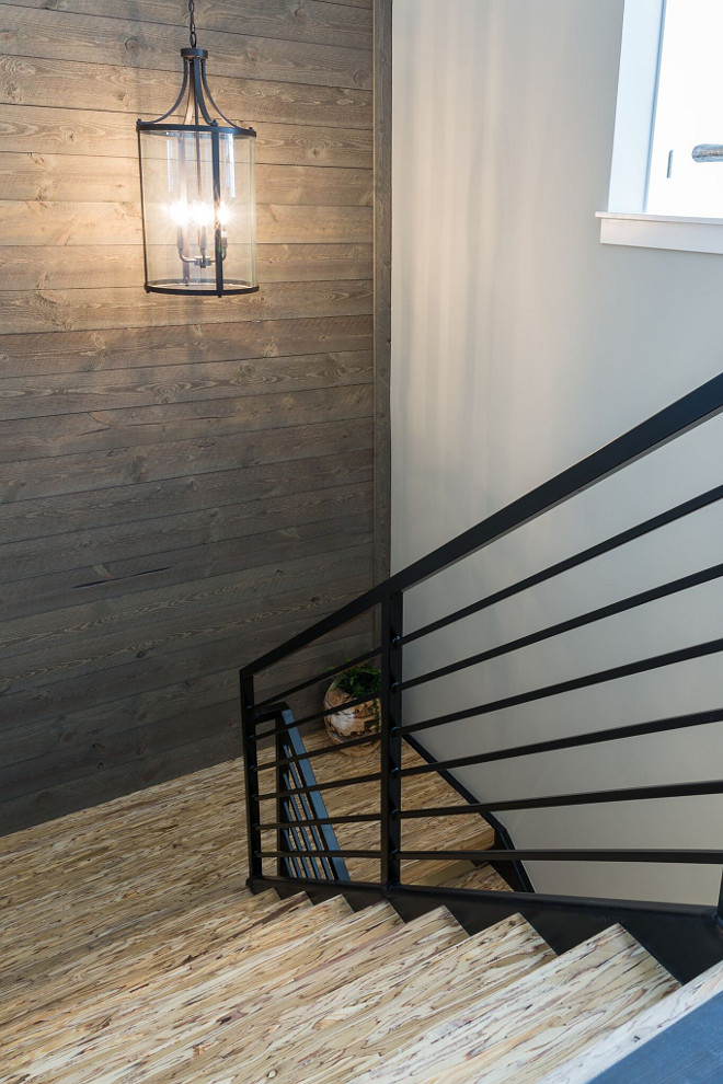 "Modern Farmhouse staircase with metal railing and Parallam stair treads ""Parallam"" is n engineered laminate lumber, often used as structural beams and posts"