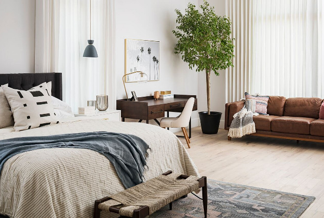 Modern farmhouse bedroom with mid-century inspired furniture. A Finer Touch Construction