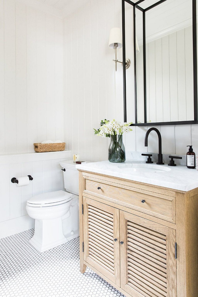 Neutral Farmhouse Bathroom with vertical shiplap, hex floor tile and Black metal mirror
