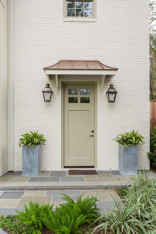 Off White Brick Exterior, The exterior features off white Off White/cream brick, copper roof details and exterior copper lanterns Pathway tile is natural Bluestone, Off White Brick Exterior with copper roof and copper exterior lanterns Off White Brick Exterior #OffWhiteBrickExterior #copperroof #copperlanterns
