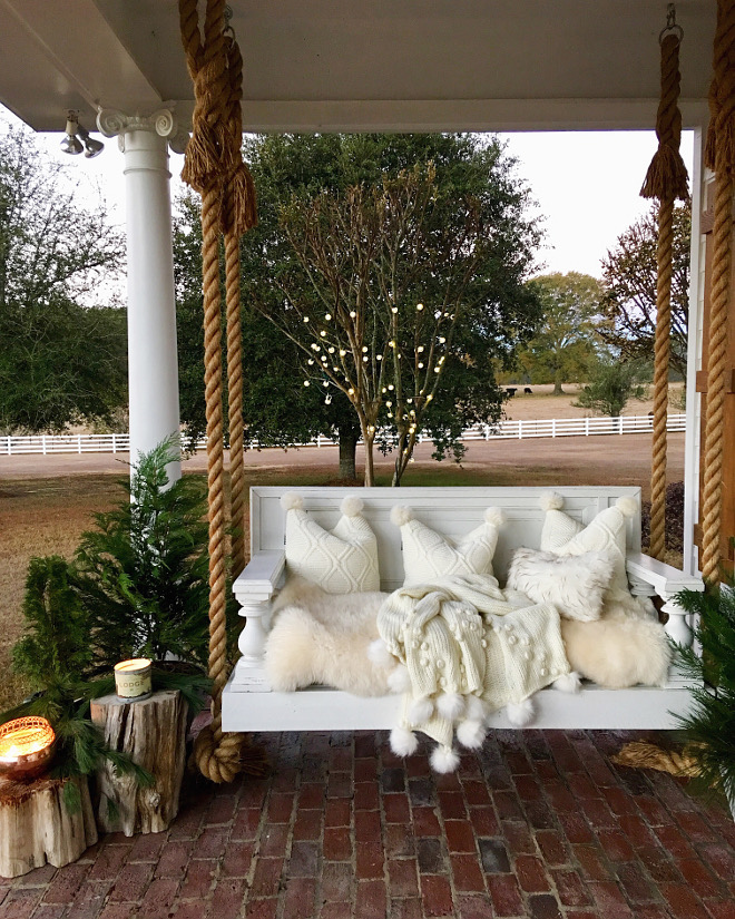 Rope Swing Porch with rope swing with white faux fur cushion, throw pillows and Anthropologie throw #ropewswing #porch #porchswing #anthropologie #pillows #throw @cindimc.ivoryhome