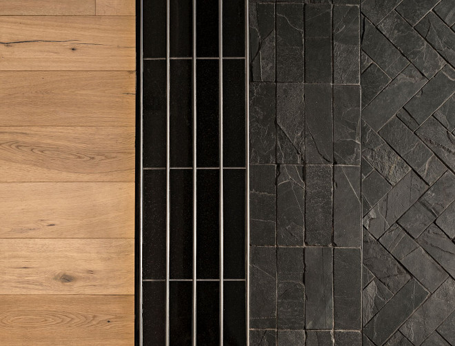 "We installed black granite inside of the track itself to blend the black door to the track. The exterior patio features black slate installed uniformly on the 4"" curb. The rest of the patio has black slate installed in a herringbone pattern. The interior of the home has engineered wood flooring. Great design choices and color palette. A Finer Touch Construction"