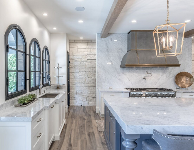 Thick Countertop. Kitchen with thick countertop. This kitchen features thick countertop edge. The countertop edge on perimeter countertops is 2.25″ and 4″ edge on island. Countertop is Carrara Marble slabs. Thick countertop kitchen ideas. Tree Haven Homes & Danielle Loryn Design