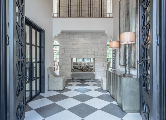 White and grey checker tile. Foyer with stone fireplace and White and grey checker tile. White and grey checker tile #Whiteandgreytile #checkertile Tree Haven Homes & Danielle Loryn Design