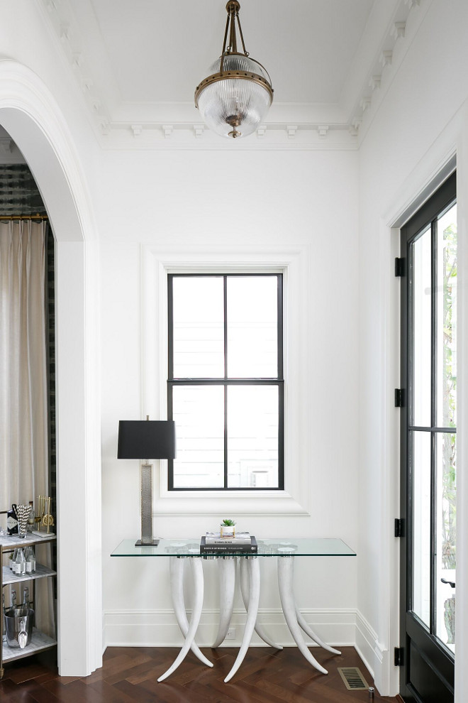 White interiors with black windows. White walls paint color Benjamin Moore OC-57 White Heron with black windows #whiteinteirors #blackwindows Ramage Company