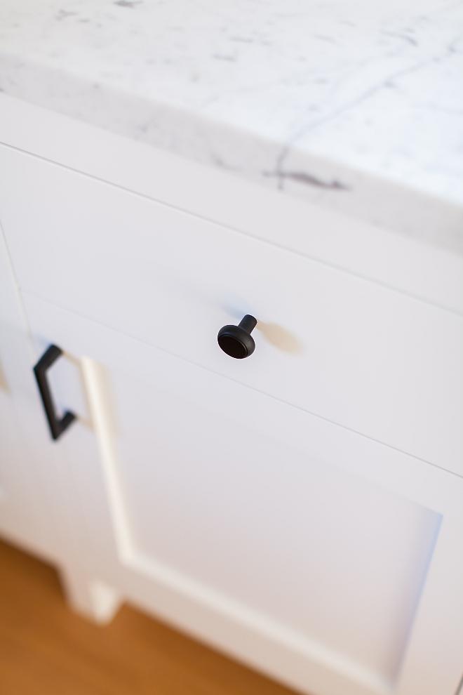 White kitchen cabinet with black hardware