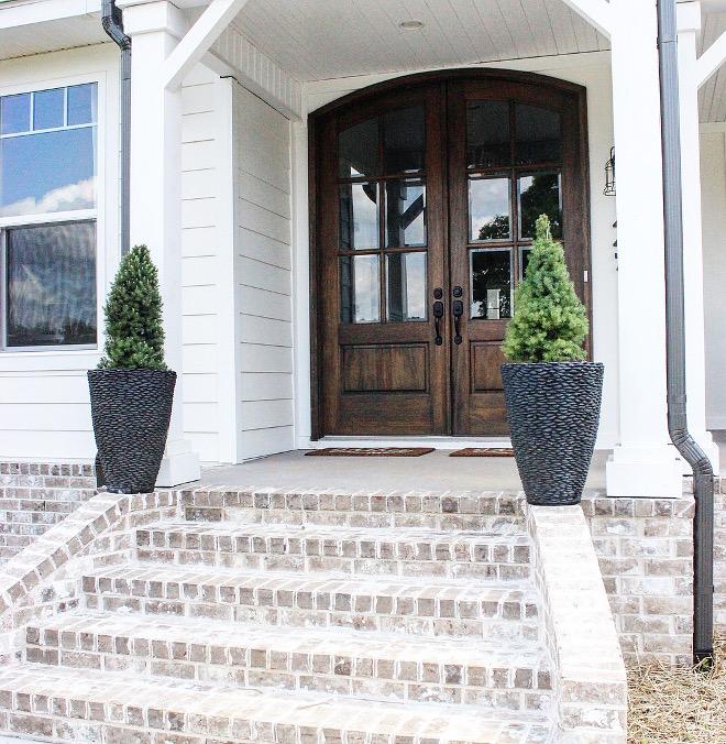"""Whitewashed exterior brick. Modern farmhouse with Whitewashed exterior brick porch Magnolia Ridge"""" General Shale, Ivory Mortar #Whitewashedexteriorbrick #Whitewashedbrick"""