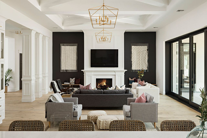 A large great room is the perfect place to entertain friends and family. The great room features 14 foot decorative ceilings and black accent walls on either side of the Isokern fireplace selected by the interior designer. A Finer Touch Construction