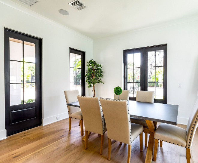 Dining room with black Doors and Windows Solar Tite / White exterior / painted black interior