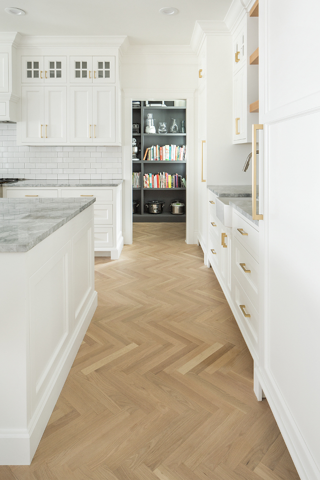 Herringbone Kitchen Flooring Herringbone hardwood kitchen flooring The flooring in the home is white oak select grade in a natural matte Bona finish Most of the main floor we did in a herringbone pattern with 2 1/4 inch plank #HerringboneKitchenFlooring #Herringbonehardwoodflooring