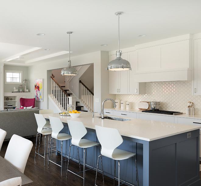 Blue kitchen island with white quartz countertop White quartz countertop constrast with the blue island