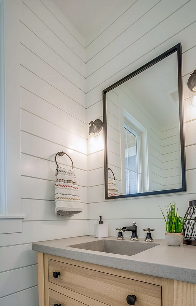 Farmhouse Bathroom Farmhouse bathroom shiplap paneling white oak vanity concrete countertop with integrated sink metal mirror #farmhousebathroom