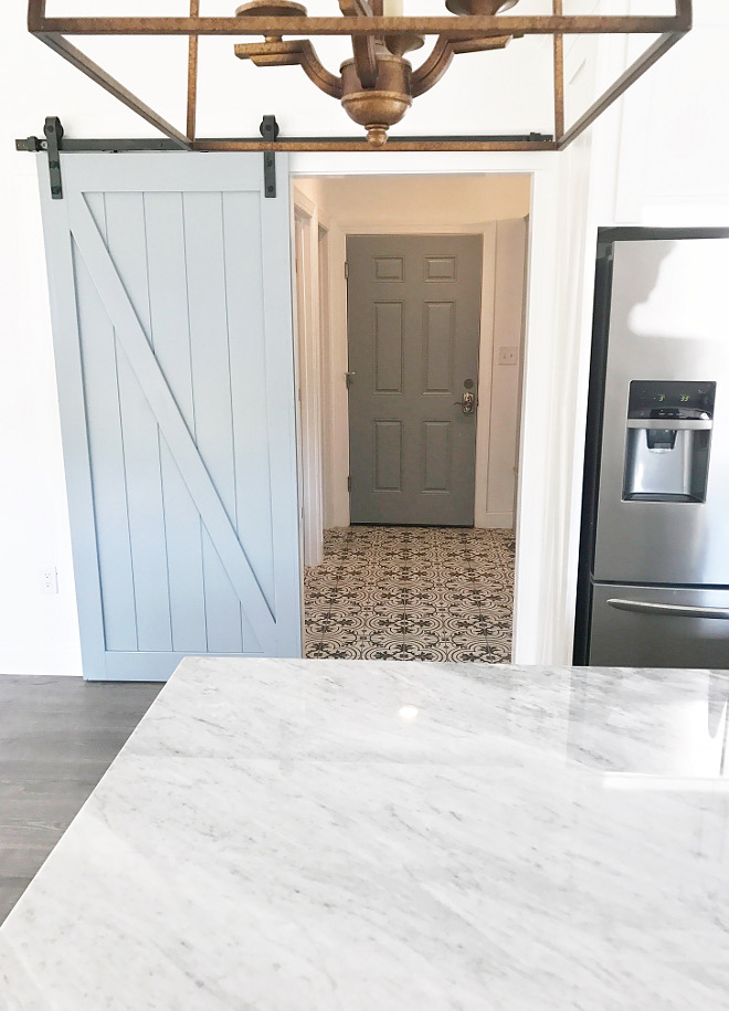 Grey Barn Door A grey barn door conceals a modern farmhouse-inspired mudroom #greybarndoor #mudroom Home Bunch Beautiful Homes of Instagram