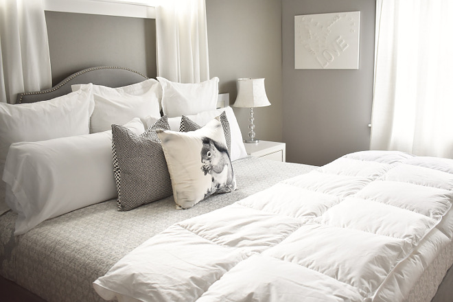 Grey Bedroom with grey and white bedding and grey headboard - Home Bunch's Beautiful Homes of Instagram