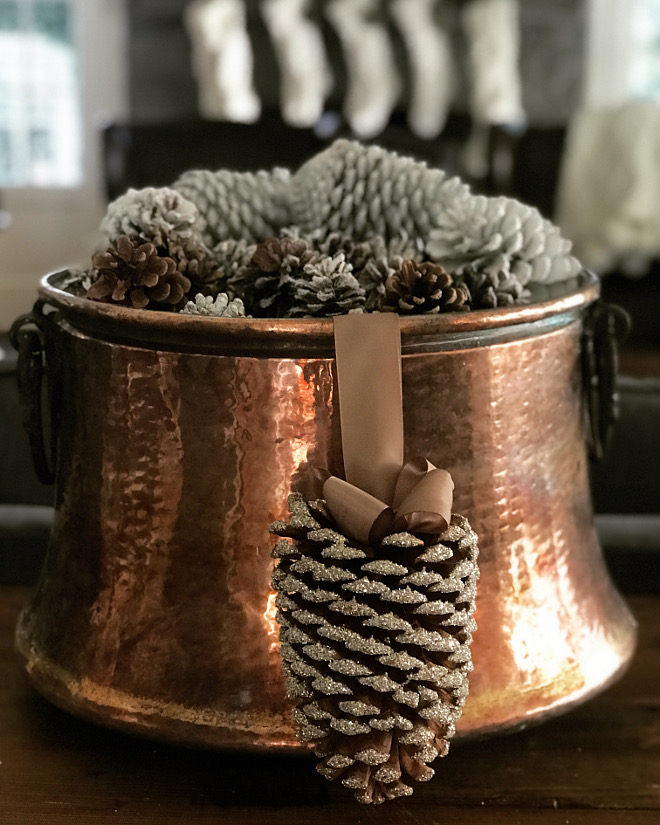 I am loving the simplicity of a copper pot filled with pine cones as a starting point for our holiday decor