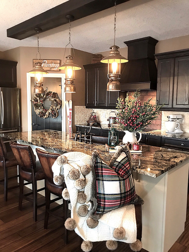 Rustic Kitchen Rustic Kitchen with antique lanterns, granite countertop and dark cabinests Rustic Kitchen