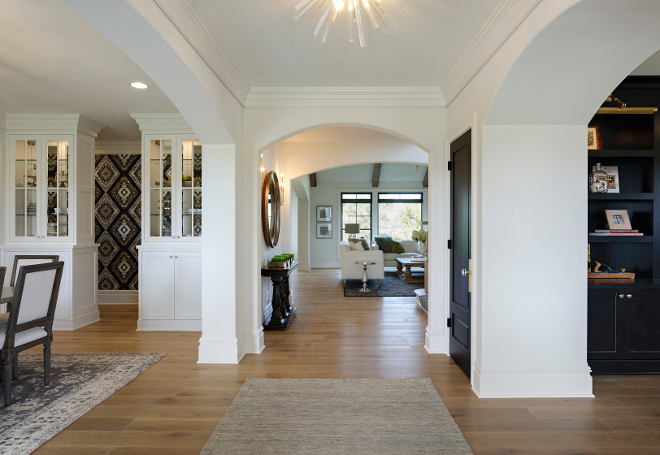The front door opens to wide foyer with arches and hardwood floors A home office is located on the right and the formal dining room is located on the left
