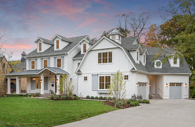 White Exterior Home With Grey Shutters And Grey Garage Doors White Exterior  Home With Grey Shutters