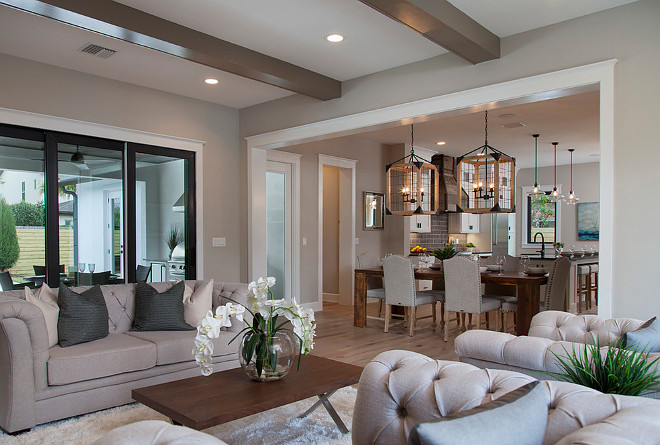 Open living room to dining room/kitchen and with sliding door access to the patio design ideas Home Bunch