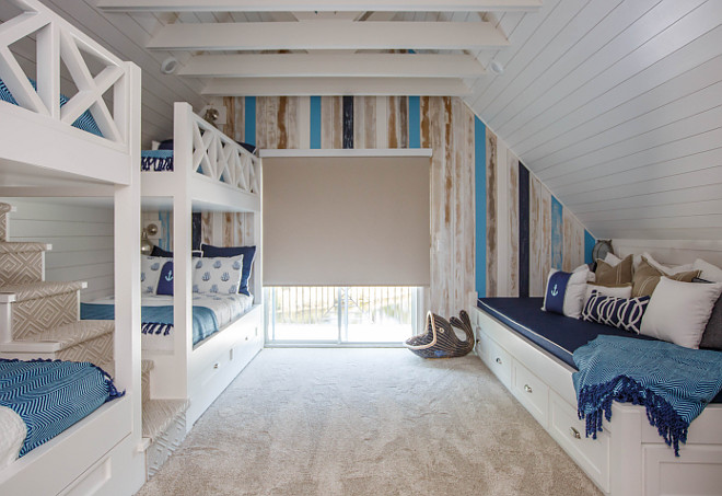 Bunk room with bunk beds and custom built in bed
