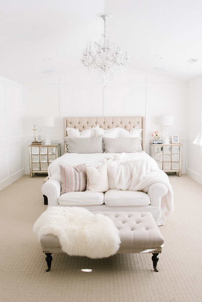 White Master Bedroom with linen bed linen bench glass chandelier grid board paneling and mirrored nightstands #whitemarterbedroom #whitebedroom