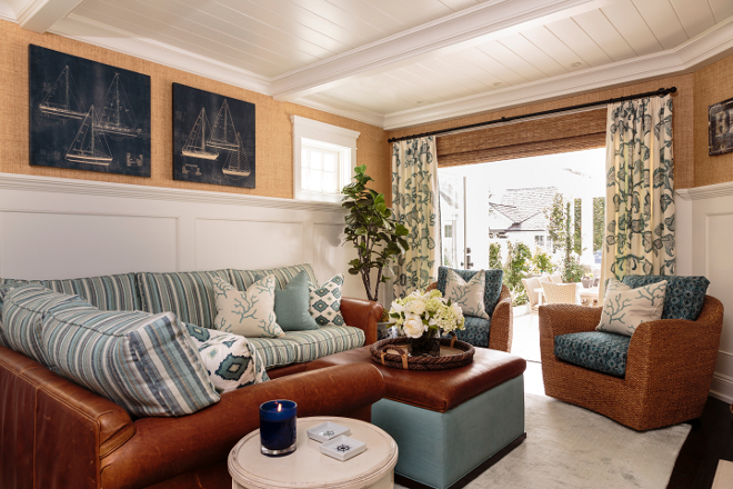 Coastal Den Coastal Den with raffia wallpaper and leather sectional