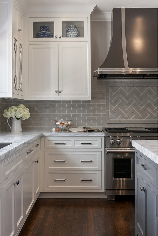 Grey backplash tile kitchen with white marble countertop and grey backplash