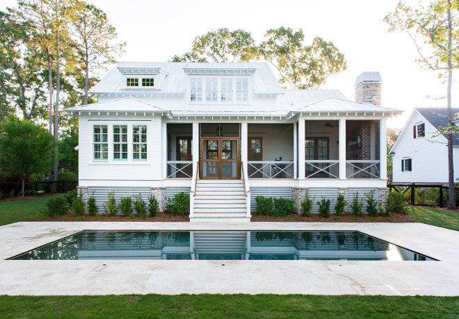 Modern Farmhouse with x deck railing and x fence The fence design above is similar to 5′ cross buck ranch design with 4×4 posts