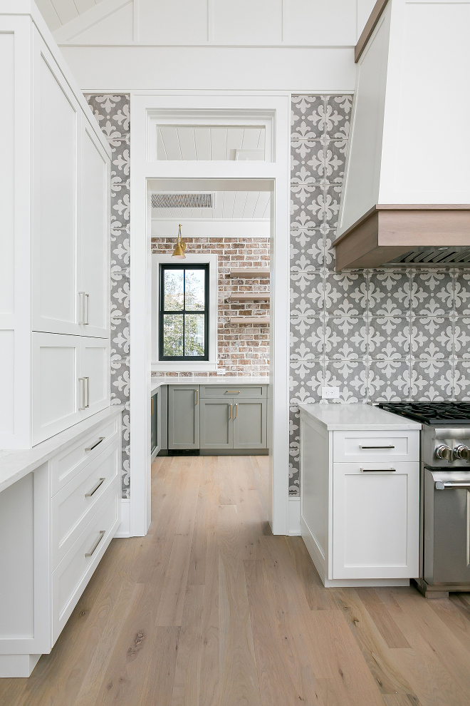 Sherwin Williams Pure White Kitchen with White Oak Hardwood Floor and Grey Cement Tile