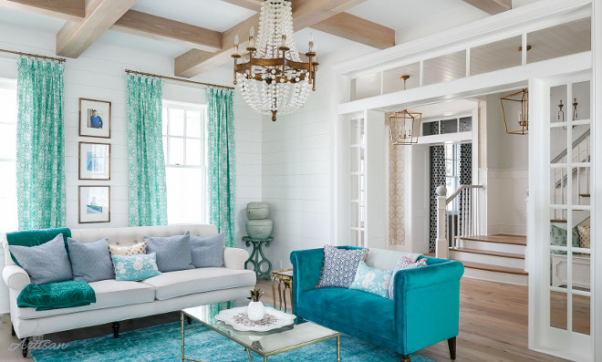 White and turquoise living room with shiplap walls