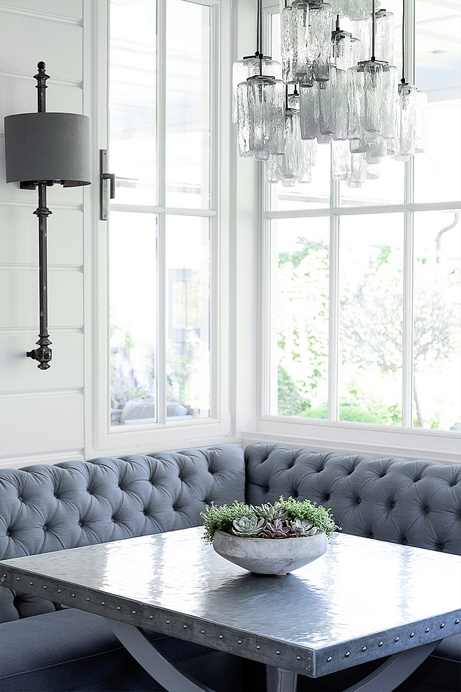 Breakfast room with tufted banquette and zinc top dining table