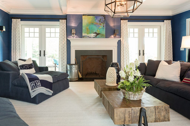 Americana Great Room The room is covered in a navy blue grasscloth wallpaper I love the textures this space features