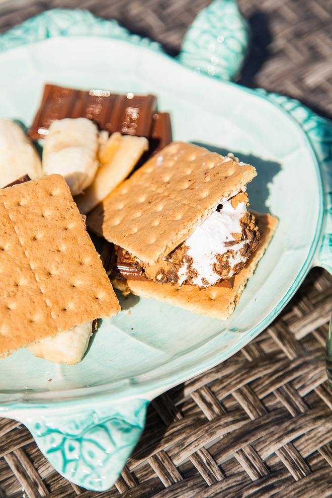 Smores fire-roasted marshmallow and a layer of chocolate sandwiched between two pieces of graham cracker