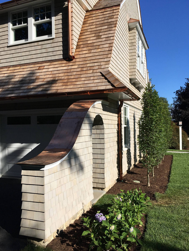 Gambrel Shingle home with copper gutter
