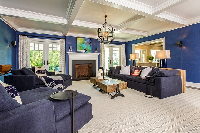 Family room features French doors flanking a fireplace