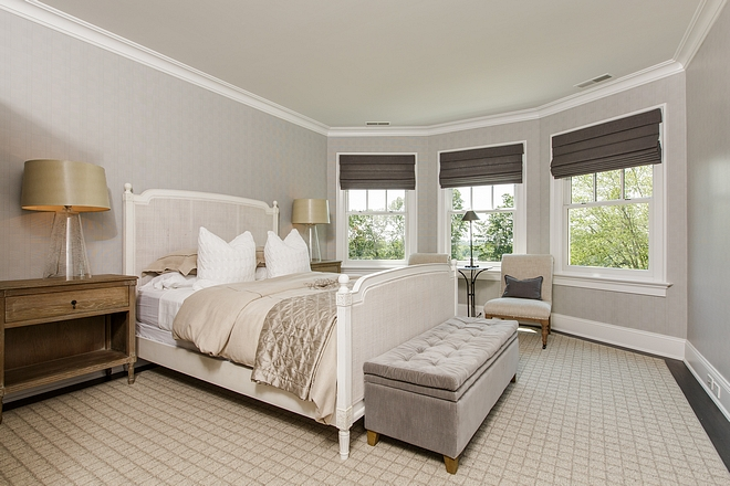 This guest suite features custom rug and bay window