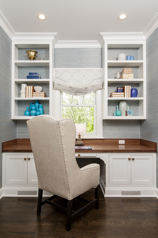 Home Office This practical home office features custom cabinetry with Walnut top and light grey wallpaper