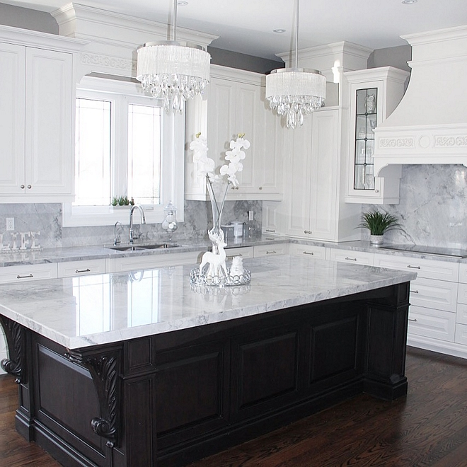 Walnut kitchen island with Superwihite quartzite countertop The island is almost 10 feet long by 4.5 ft wide The elegant corbels also add a touch of style