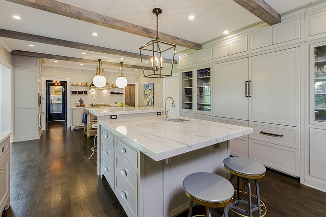 Grey kitchen with two islands Grey kitchen cabinet with two island and ceiling beams grey kitchen