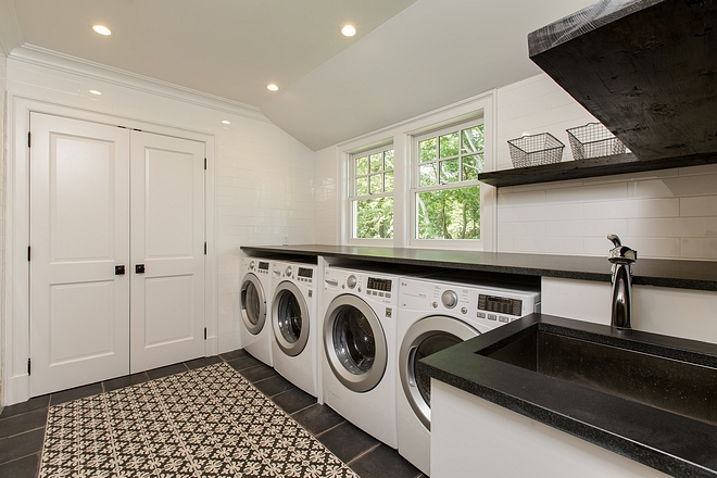 Laundry room Main laundry room features double set of washer and dryer Countertop is honed Black Granite