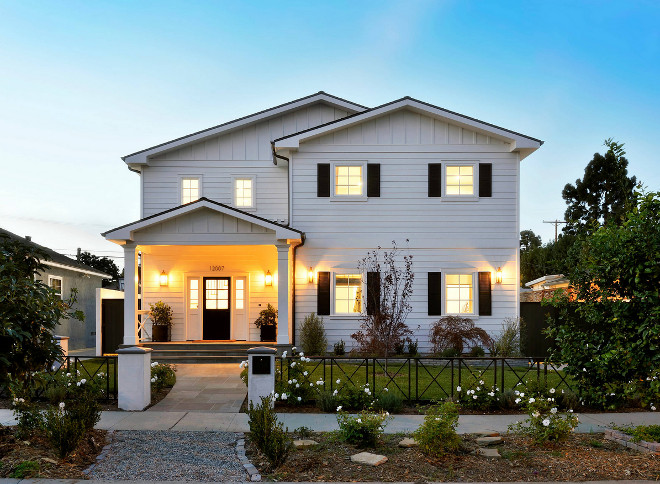 Modern Farmhouse with black door and black shutters