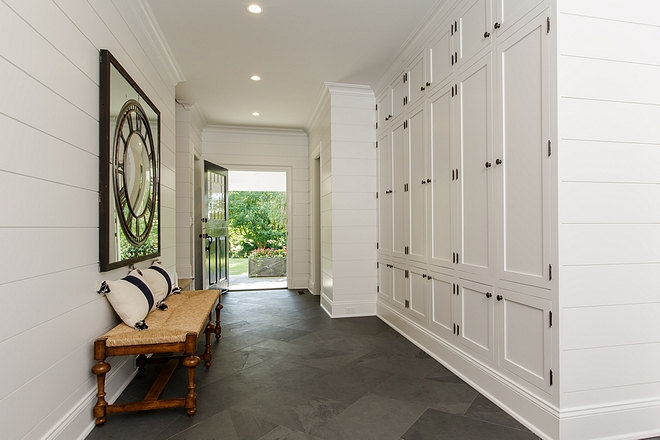 Gorgeous side entry and mudroom. I love the natural stone flooring and the shiplap